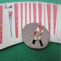 Karten-Münze Kreuz König
